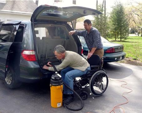 Licensed Home Care Agency Helping Member Vacuum Car